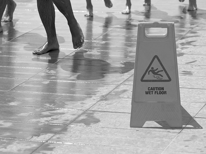 warning signs on the slippery floor